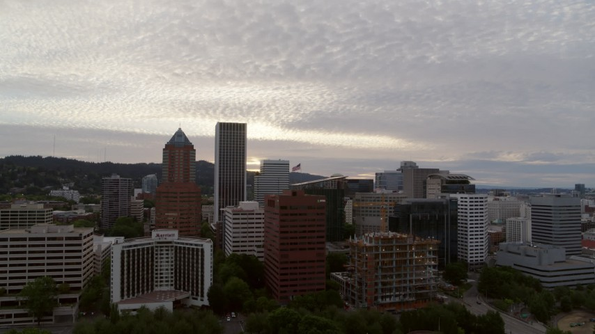 5.7K stock footage aerial video flying away from downtown office buildings at twilight, Downtown Portland, Oregon Aerial Stock Footage | DX0001_000309