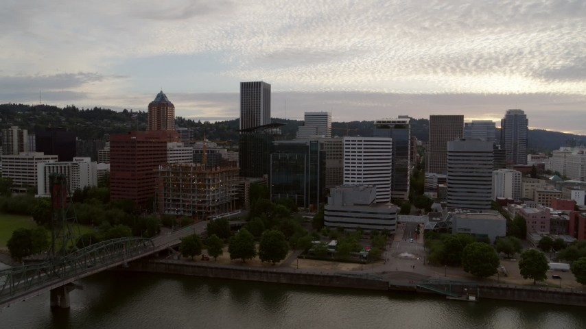 5.7K stock footage aerial video of Downtown Portland skyline seen from Willamette River at twilight, Oregon Aerial Stock Footage | DX0001_000310