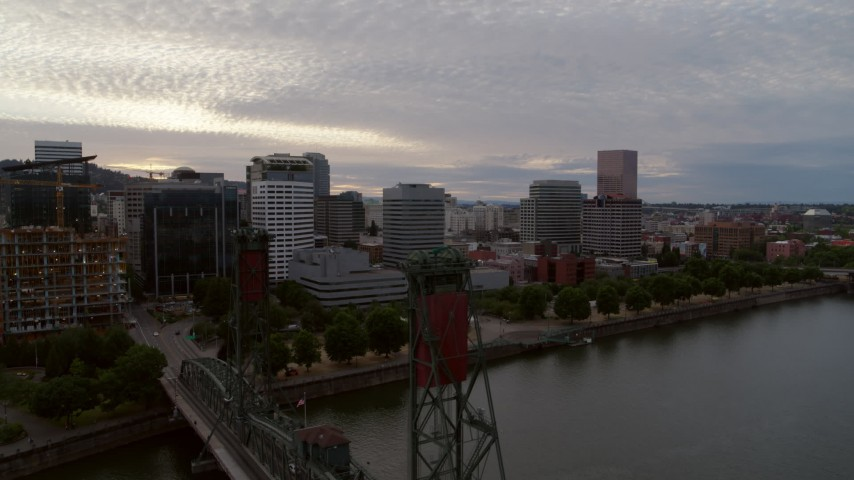 5.7K stock footage aerial video of riverfront office buildings and seen from Hawthorne Bridge, twilight, Downtown Portland, Oregon Aerial Stock Footage | DX0001_000311