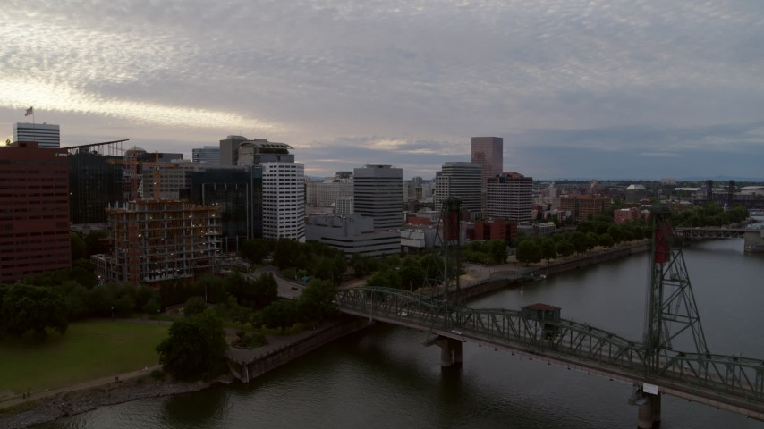 5.7K stock footage aerial video of Hawthorne Bridge and office buildings along the water, twilight, Downtown Portland, Oregon Aerial Stock Footage | DX0001_000312