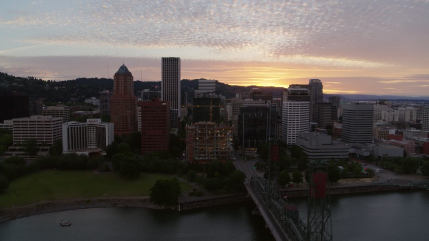 5.7K stock footage aerial video of flying by Downtown Portland, Oregon at twilight Aerial Stock Footage | DX0001_000313