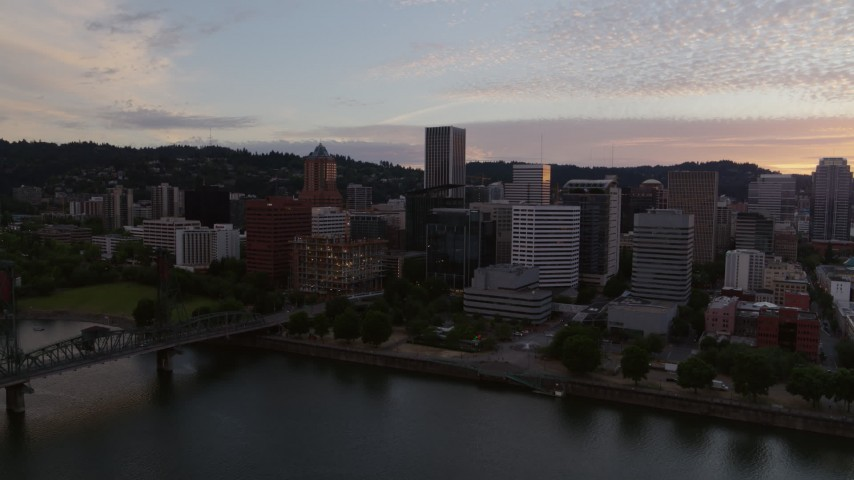 6K aerial video flying by downtown Portland, OR during sunset Aerial Stock Footage | DX0001_000314