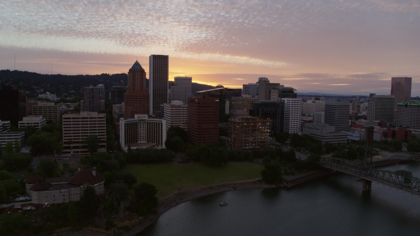 5.7K stock footage aerial video flying toward Downtown Portland, Oregon at twilight Aerial Stock Footage | DX0001_000315