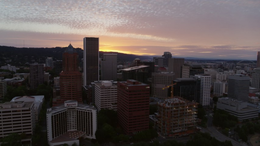 5.7K stock footage aerial video of flying away from skyscrapers and waterfront park in Downtown Portland, Oregon, twilight Aerial Stock Footage | DX0001_000316