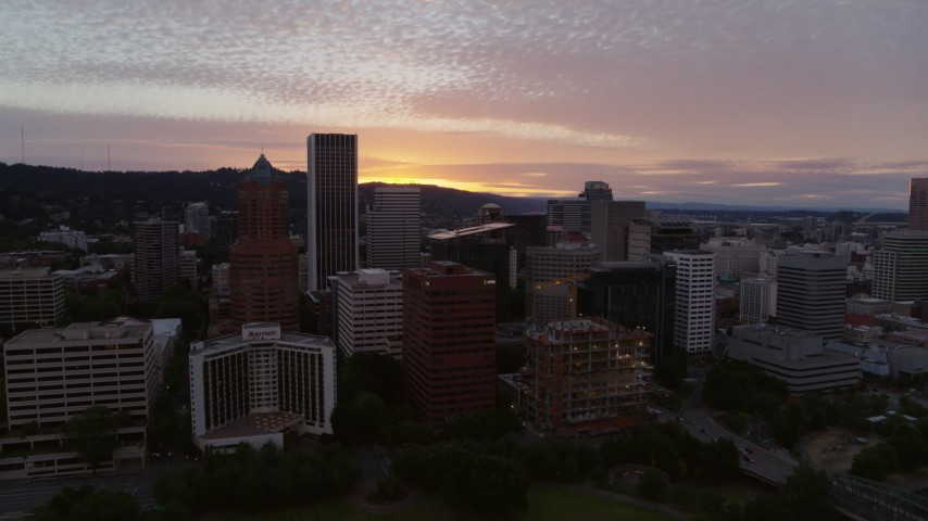 5.7K stock footage aerial video approaching and flying by the downtown skyline at twilight in Downtown Portland, Oregon Aerial Stock Footage | DX0001_000317