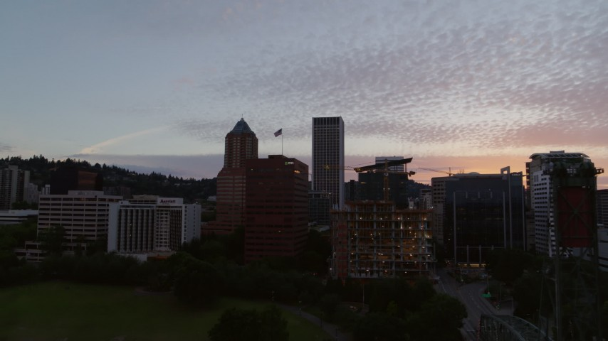 5.7K stock footage aerial video descending over the Willamette River with a view of Downtown Portland, Oregon at twilight Aerial Stock Footage | DX0001_000318