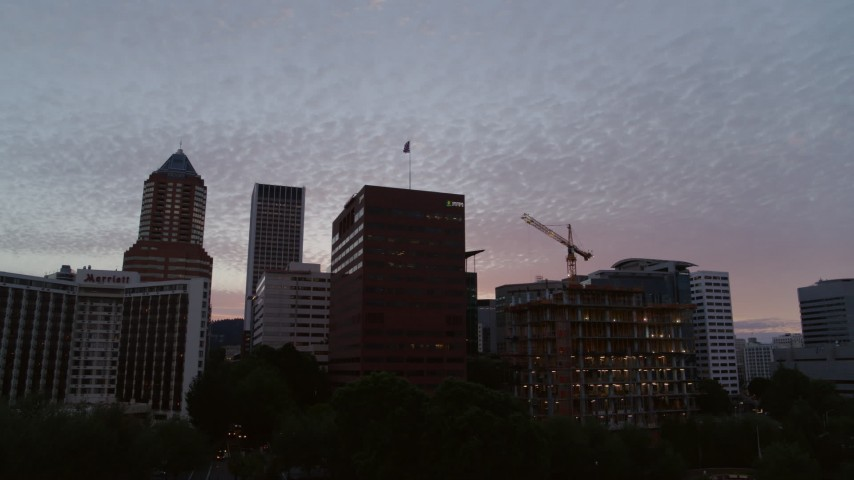 5.7K stock footage aerial video of flying low away from office buildings in Downtown Portland, Oregon, twilight Aerial Stock Footage | DX0001_000319