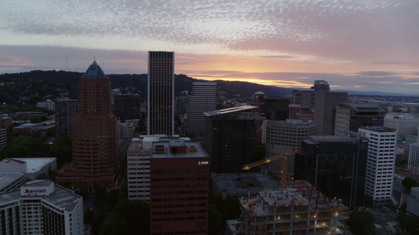5.7K stock footage aerial video orbiting tall skyscrapers in Downtown Portland, Oregon at twilight Aerial Stock Footage | DX0001_000322