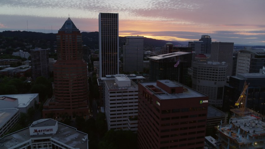 5.7K stock footage aerial video of a reverse view of Downtown Portland, Oregon skyscrapers at twilight Aerial Stock Footage | DX0001_000326
