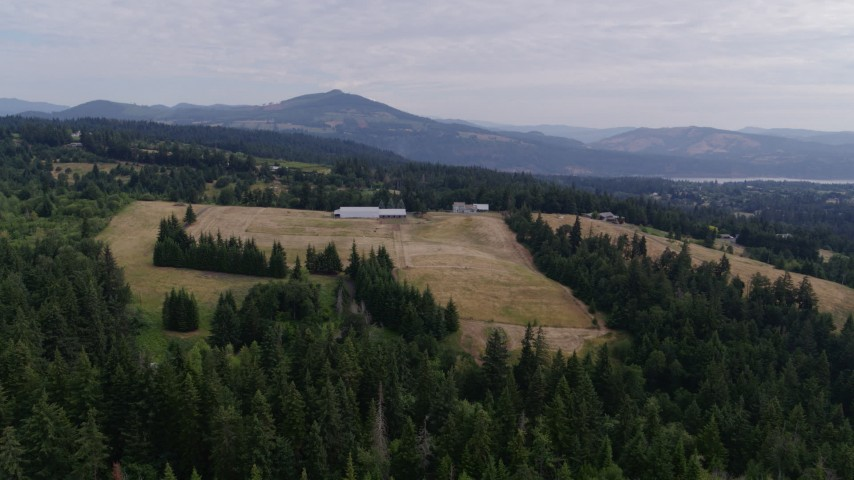 5.7K aerial video of a stationary view of a farm and fields, Hood River, Oregon Aerial Stock Footage | DX0001_000339