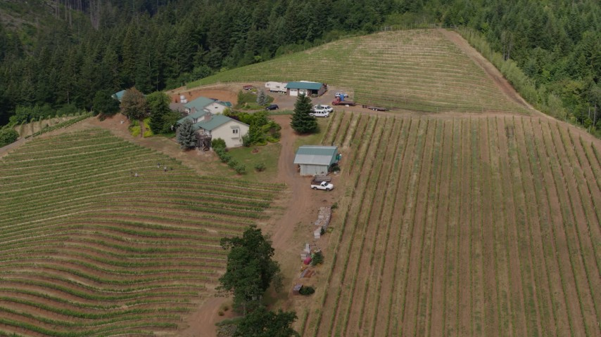 5.7K aerial video approach and flyby a hilltop winery and vineyards, Hood River, Oregon Aerial Stock Footage | DX0001_000368