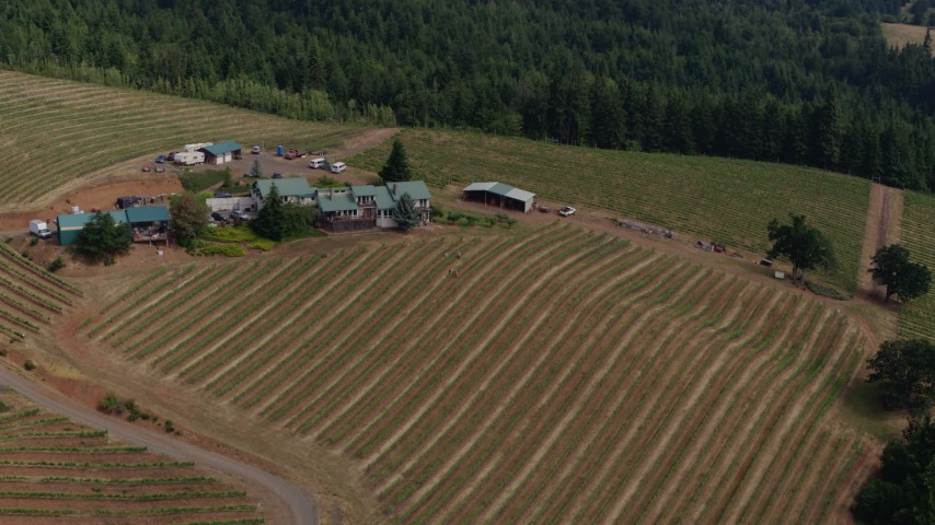 5.7K aerial video approach and fly past a winery and vineyards in Hood River, Oregon Aerial Stock Footage | DX0001_000370