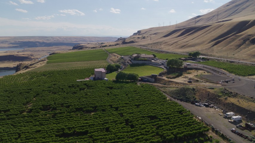 5.7K stock footage aerial video of flying over grapevines to approach Maryhill Winery in Goldendale, Washington Aerial Stock Footage | DX0001_000444