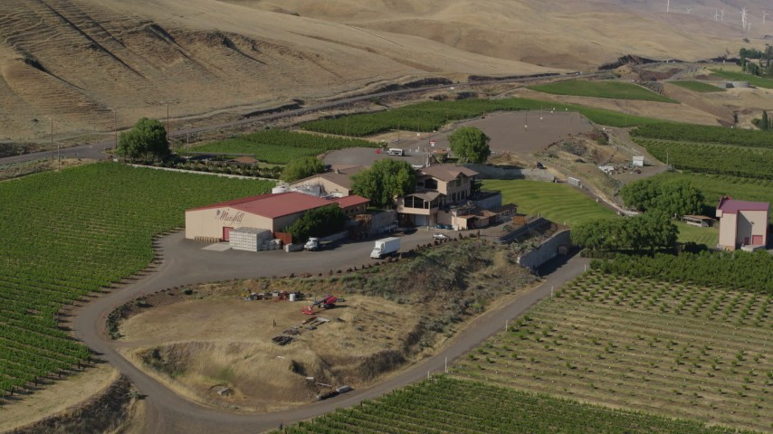 5.7K stock footage aerial video of approaching buildings at the Maryhill Winery in Goldendale, Washington Aerial Stock Footage | DX0001_000453