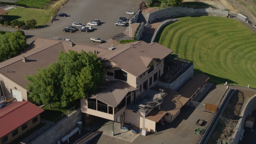 5.7K stock footage aerial video of flying by outside tasting area at the Maryhill Winery in Goldendale, Washington Aerial Stock Footage   DX0001_000454