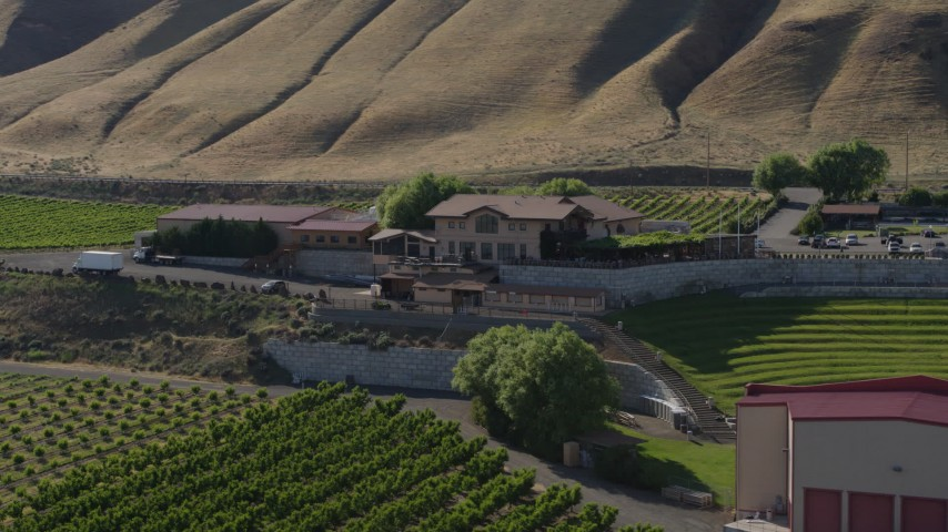 5.7K stock footage aerial video of passing the Maryhill Winery and amphitheater in Goldendale, Washington Aerial Stock Footage | DX0001_000467