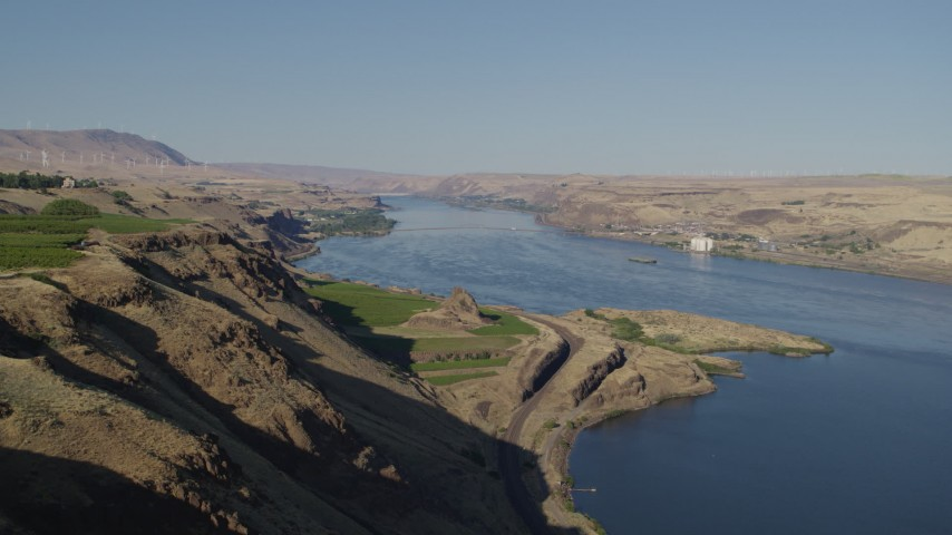 5.7K stock footage aerial video flyby the Columbia River to reveal Maryhill Winery and vineyard in Goldendale, Washington Aerial Stock Footage | DX0001_000476