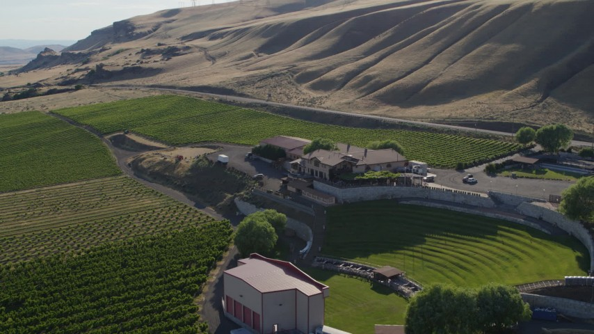 5.7K stock footage aerial video fly over amphitheater to orbit Maryhill Winery main building in Goldendale, Washington Aerial Stock Footage | DX0001_000489