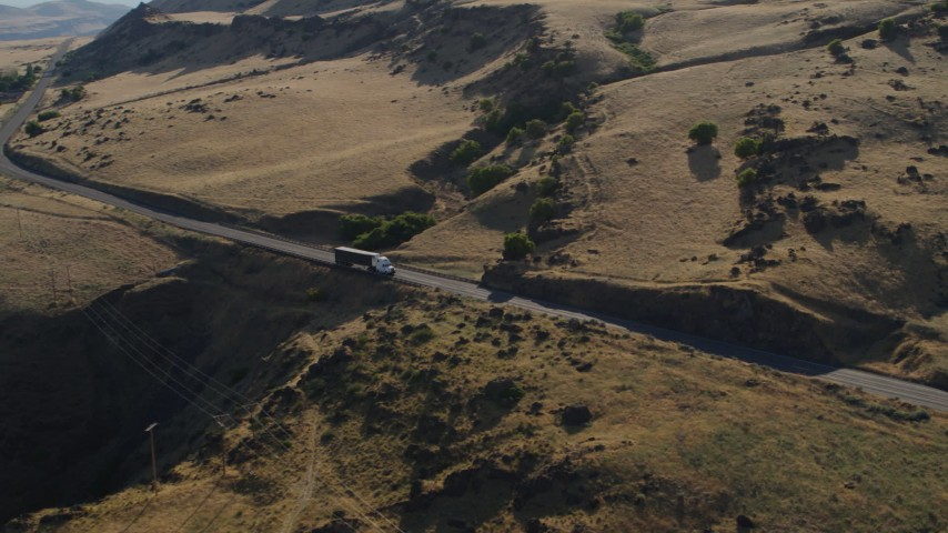 5.7K stock footage aerial video of a big rig traveling on Lewis and Clark Highway in Goldendale, Washington Aerial Stock Footage | DX0001_000502