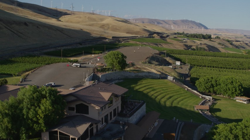 5.7K stock footage aerial video of a reverse view of the Maryhill Winery and amphitheater in Goldendale, Washington Aerial Stock Footage   DX0001_000505