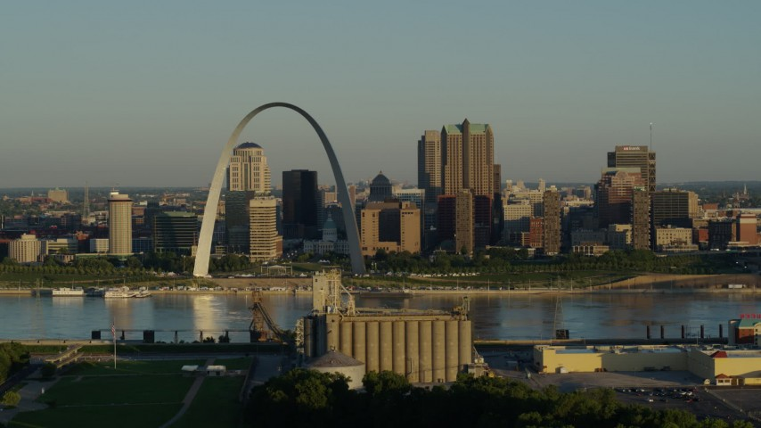 5.7K stock footage aerial video of The Arch and city skyline across the Mississippi River, sunrise, Downtown St. Louis, Missouri Aerial Stock Footage | DX0001_000511
