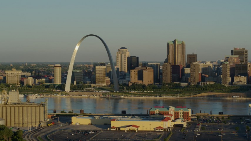 5.7K stock footage aerial video of The Arch and skyline, passing by a casino by the Mississippi River, sunrise, Downtown St. Louis, Missouri Aerial Stock Footage | DX0001_000512