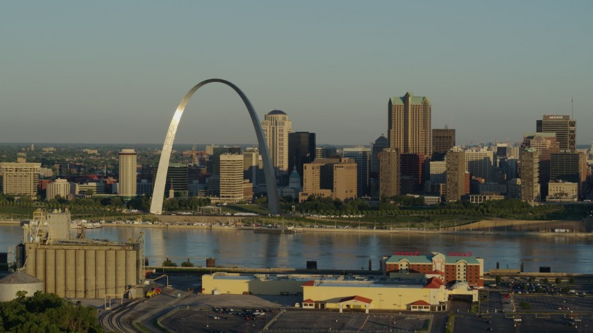 5.7K stock footage aerial video of The Arch and skyline seen from across the Mississippi River at sunrise, Downtown St. Louis, Missouri Aerial Stock Footage | DX0001_000513