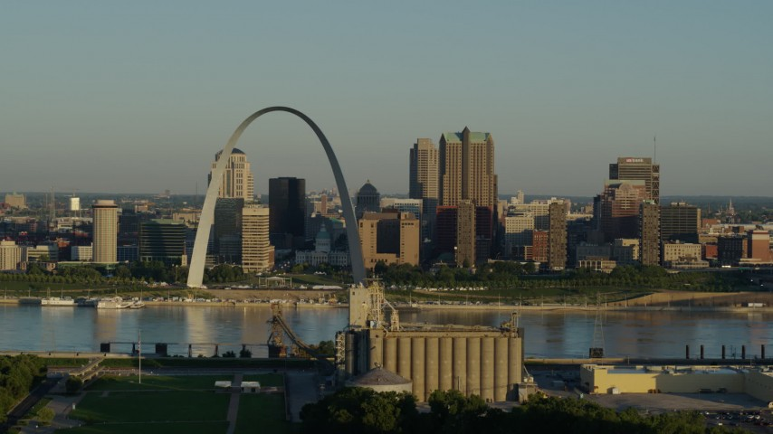 5.7K stock footage aerial video passing by a grain elevator and casino against The Arch and skyline at sunrise, Downtown St. Louis, Missouri Aerial Stock Footage | DX0001_000514