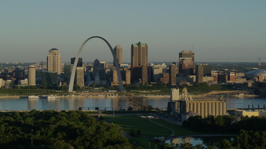 5.7K aerial video of the skyline and Museum at the Gateway Arch along the Mississippi River, sunrise, Downtown St. Louis, Missouri Aerial Stock Footage | DX0001_000516