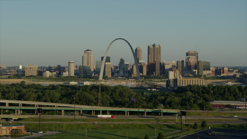 5.7K stock footage aerial video descending below the interstate looking toward the Arch and skyline, sunrise, Downtown St. Louis, Missouri Aerial Stock Footage | DX0001_000522