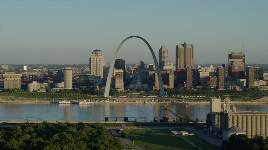 5.7K stock footage aerial video approaching Mississippi River and Gateway Arch among skyline, sunrise, Downtown St. Louis, Missouri Aerial Stock Footage DX0001_000524 | Axiom Images
