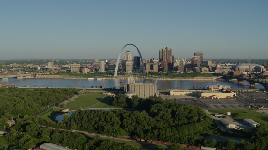 5.7K stock footage aerial video of the Arch and skyline seen from a park in East St. Louis, sunrise, Downtown St. Louis, Missouri Aerial Stock Footage | DX0001_000535