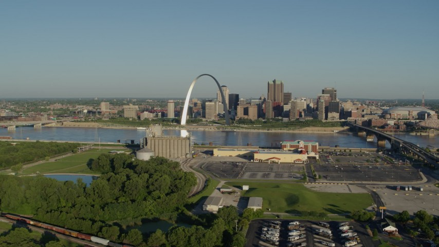 5.7K stock footage aerial video of the Arch and skyline seen from across the Mississippi River, sunrise, Downtown St. Louis, Missouri Aerial Stock Footage | DX0001_000539