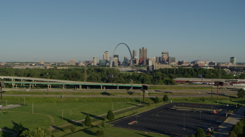 5.7K aerial video of city skyline and Arch while descending below a freeway in East St. Louis, sunrise, Downtown St. Louis, Missouri Aerial Stock Footage | DX0001_000545