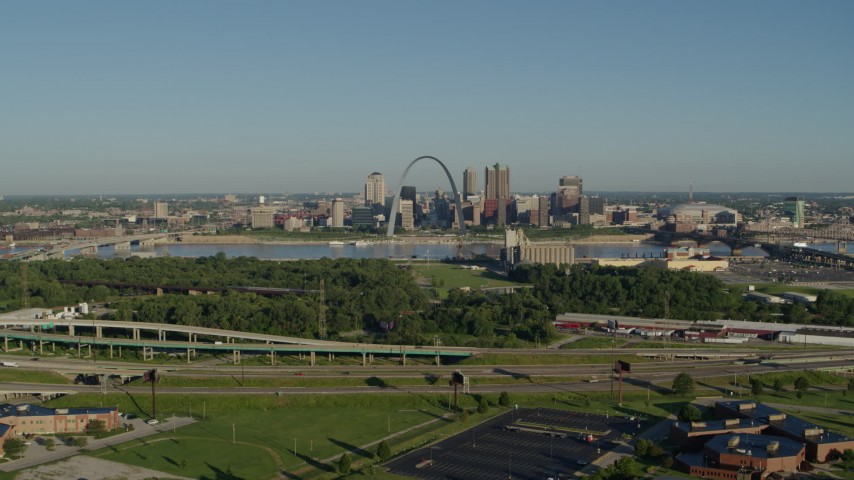 5.7K stock footage aerial video of freeway and park in East St. Louis, looking toward Arch and skyline, sunrise, Downtown St. Louis, Missouri Aerial Stock Footage | DX0001_000549