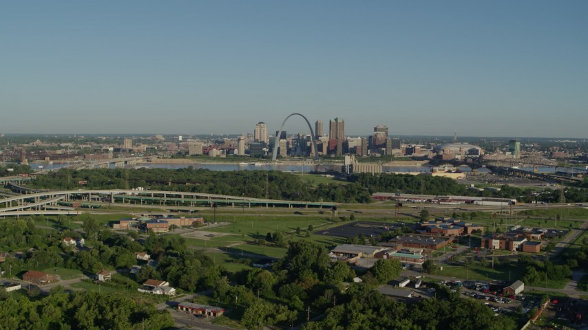 5.7K stock footage aerial video wide angle of skyline and Arch from interstate and park, sunrise, Downtown St. Louis, Missouri Aerial Stock Footage | DX0001_000550