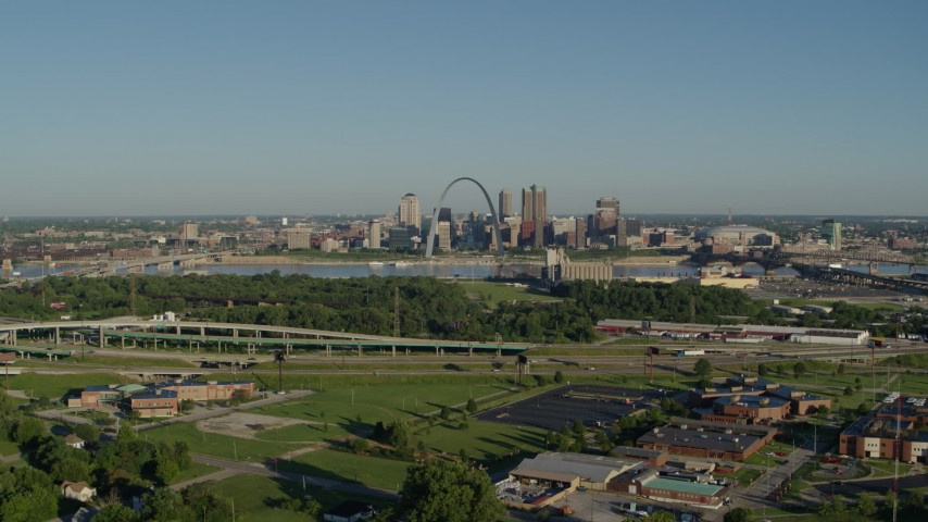 5.7K stock footage aerial video of school and interstate in East St. Lous toward skyline and Arch, sunrise, Downtown St. Louis, Missouri Aerial Stock Footage | DX0001_000551
