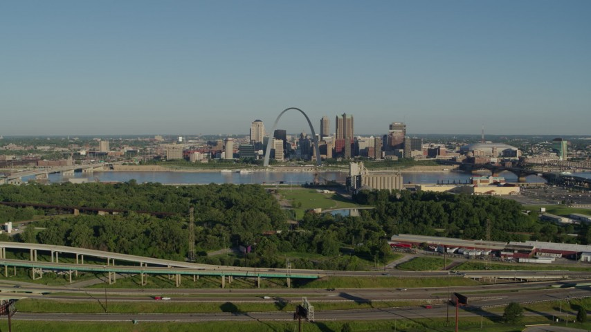 5.7K stock footage aerial video of skyline and Arch from freeway and park in East St. Louis, sunrise, Downtown St. Louis, Missouri Aerial Stock Footage | DX0001_000552