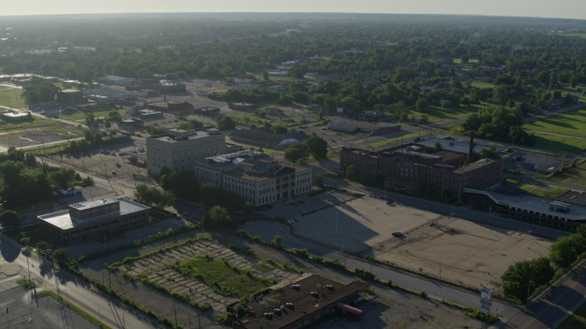 5.7K aerial video wide angle of a federal courthouse and abandoned hospital, sunrise, East St Louis, Illinois Aerial Stock Footage | DX0001_000559