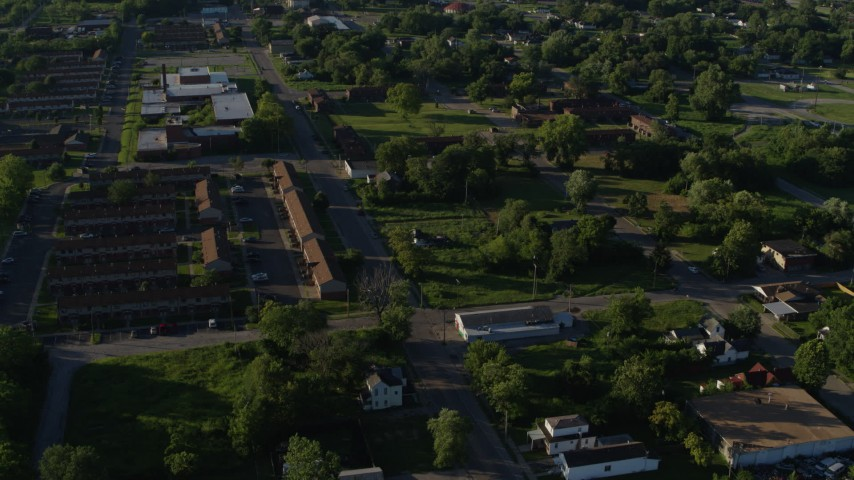 5.7K stock footage aerial video approaching apartment buildings among trees, sunrise, East St Louis, Illinois Aerial Stock Footage | DX0001_000561