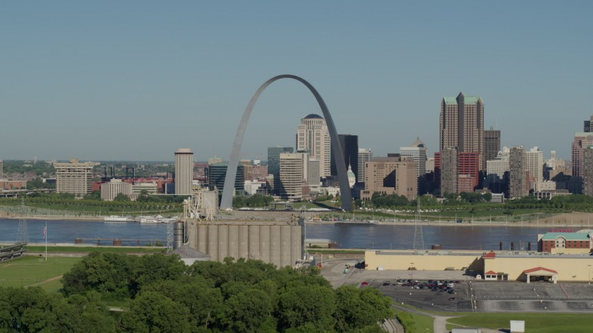 5.7K stock footage aerial video of grain elevator and casino with the Arch and skyline in the background, Downtown St. Louis, Missouri Aerial Stock Footage | DX0001_000566