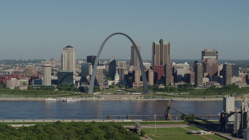 5.7K stock footage aerial video of a grain elevator ascending to show the Gateway Arch and its museum, Downtown St. Louis, Missouri Aerial Stock Footage | DX0001_000567