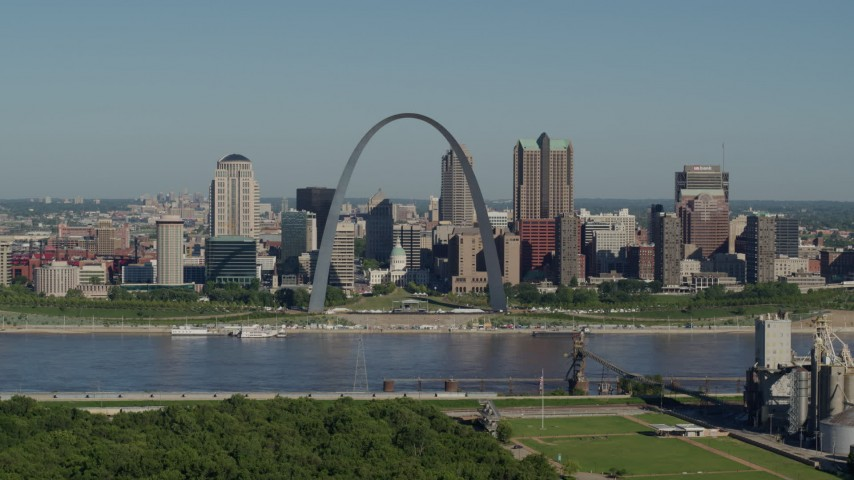 5.7K stock footage aerial video reverse from the Arch and skyline, Downtown St. Louis, Missouri Aerial Stock Footage | DX0001_000568