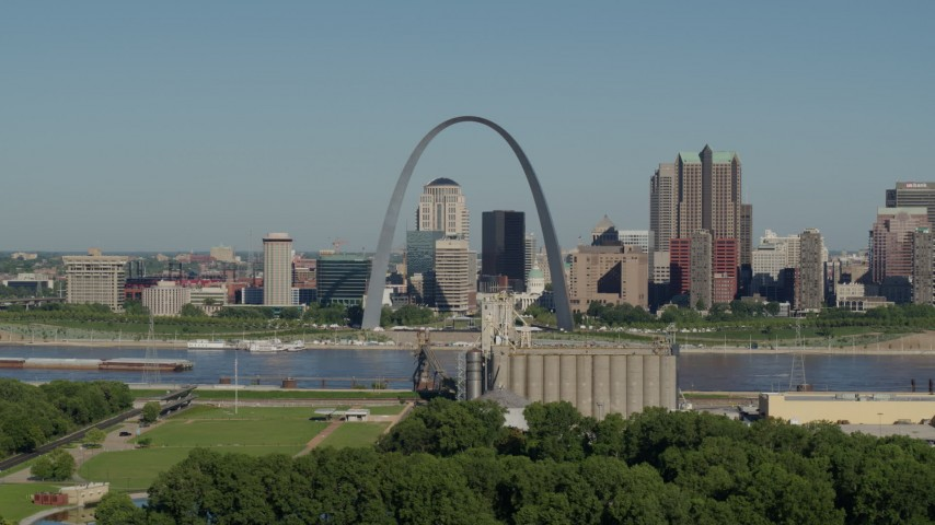 5.7K stock footage aerial video of grain elevator and St. Louis Arch among city skyline, Downtown St. Louis, Missouri Aerial Stock Footage | DX0001_000571