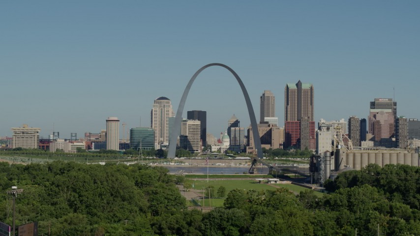 5.7K stock footage aerial video descending below the Arch and city skyline, Downtown St. Louis, Missouri Aerial Stock Footage | DX0001_000575