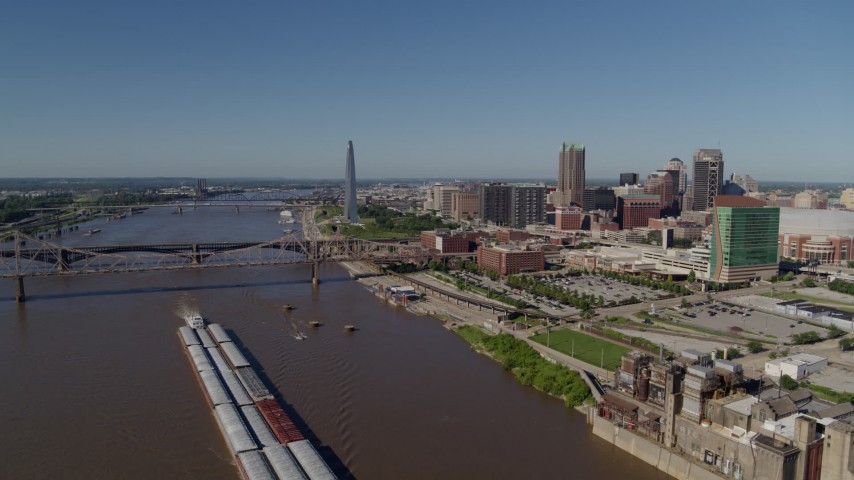 5.7K stock footage aerial video flying over Mississippi River with barges near Downtown St. Louis, Missouri Aerial Stock Footage | DX0001_000577
