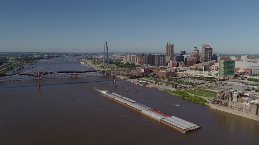 5.7K stock footage aerial video of barges in the Mississippi River near Downtown St. Louis, Missouri Aerial Stock Footage | DX0001_000578
