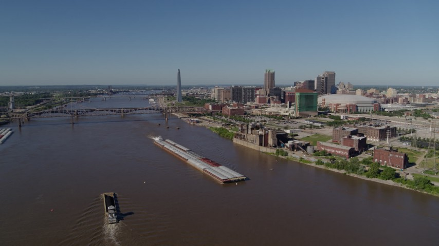5.7K aerial video of barges in the Mississippi River and the city in the distance, Downtown St. Louis, Missouri Aerial Stock Footage | DX0001_000581