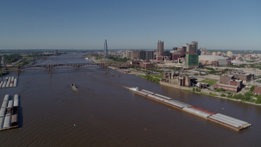 5.7K stock footage aerial video of a view of riverfront buildings and barges on the river, Downtown St. Louis, Missouri Aerial Stock Footage | DX0001_000584