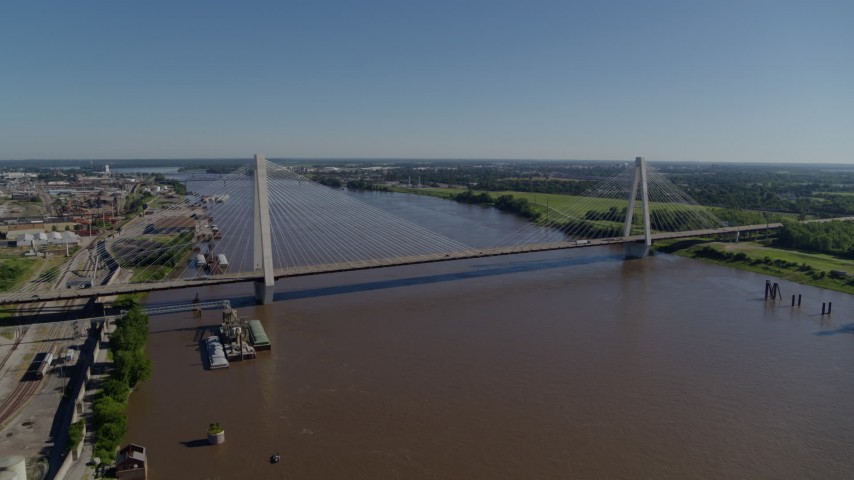 5.7K stock footage aerial video reverse from cable-stayed bridge spanning the Mississippi River revealing barges, St. Louis, Missouri Aerial Stock Footage | DX0001_000589